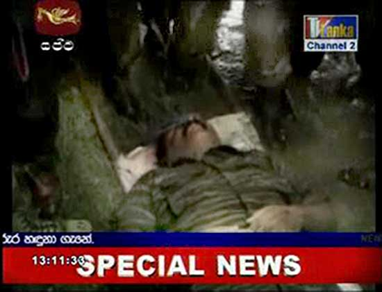 The video frame grab shows the body of Prabhakaran