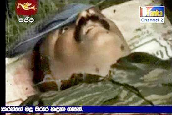 Sri Lankan TV stations aired video of what appeared to be LTTE chief's corpse, with the top of its head blown off