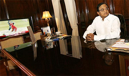 Union Home Minister P Chidambaram sits inside his office on the first day