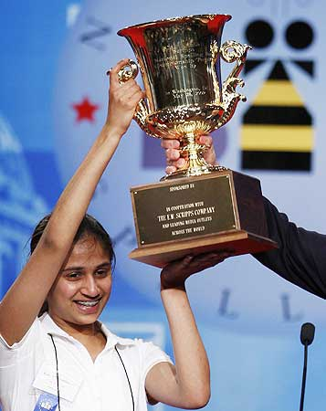 Speller Kavya Shivashankar from Olathe, Kansas, lifts the trophy after winning the 2009 National S