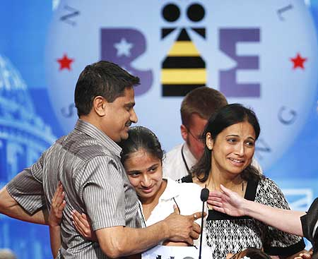 Speller Kavya is congratulated by her father Mirle Shivashankar and mother Sandhya