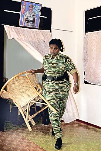 Thamilini provides a chair for visitors at her official residence in Kilinochchi. File picture