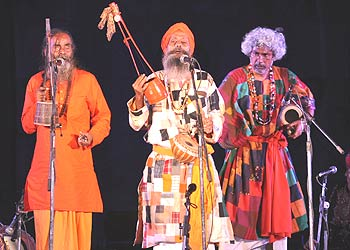Baul singers Kanai, left, and Debdas, centre, perform at the launch of Nine Lives in Delhi