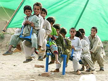 Children displaced by the offensive in Swat Valley play at the Yar Hussain camp in Swabi district