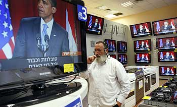An Israeli salesperson in Tel Aviv listens to US President Barack Obama's Cairo speech