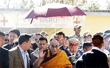 The Dalai Lama arrives at a hospital at Tawang
