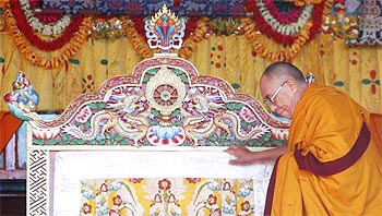 The Dalai Lama arrives on stage to deliver Buddhist teachings at Tawang