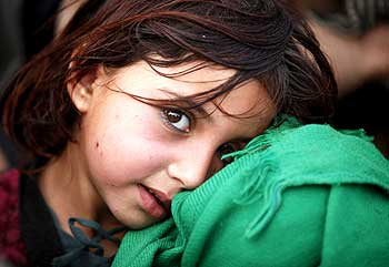 Rabiya, fleeing an offensive in South Waziristan, waits with her father at a refugee camp.