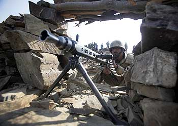 A Pakistani soldier poses for the media.