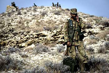 A Pakistani soldier speaks on a military field phone.