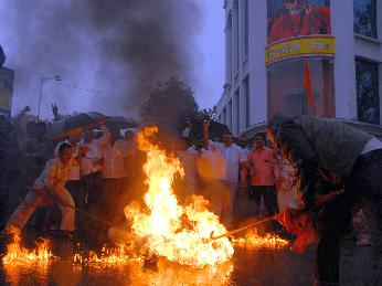 Shiv Sainiks burn an effigy of SP leader Abu Azmi outside Sena Bhavan on Wednesday