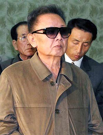 -North Korean leader Kim Jong-il during a visit to a factory