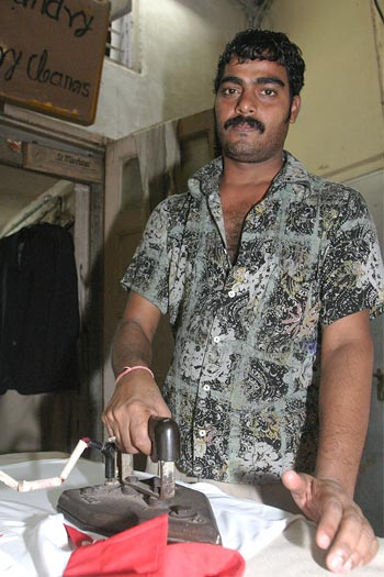 Santosh Kanojia in his rented space at St Michael's laundry in Colaba