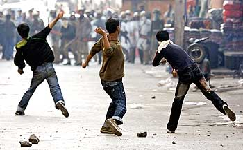 Kashmiri protesters throw stones and bricks at policemen during a demonstration.