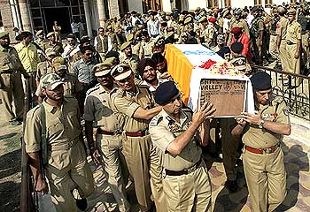 Senior police officers carry the coffin of one of their colleagues during the wreath-laying ceremony in Srinagar.