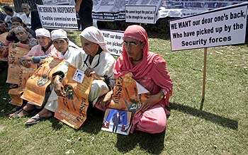 Kashmiri relatives of missing persons hold placards during a peaceful demonstration organised by the Association of Parents of Disappeared Persons in Srinagar.