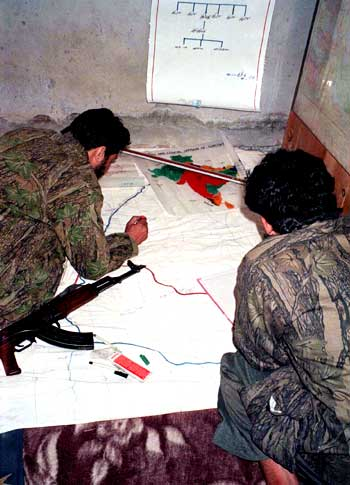 Lashkar terrorists study a map of a target in Jammu and Kashmir.