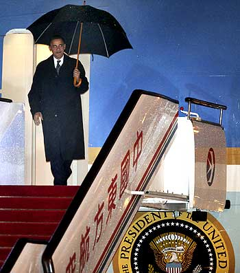 US President Barack Obama steps out of Air Force One at Pudong International Airport in Shanghai