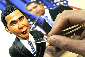 An artist crafts a figurine made from flour and water of US President Barack Obama in Shenyang, Liaoning province, China