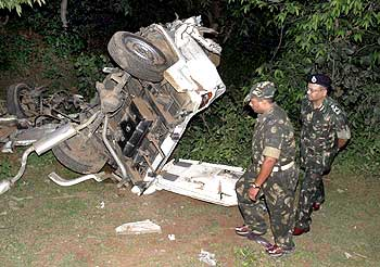 Police officers at the site of a landmine explosion in Pundgiri, Jharkhand, June 30, 2008.