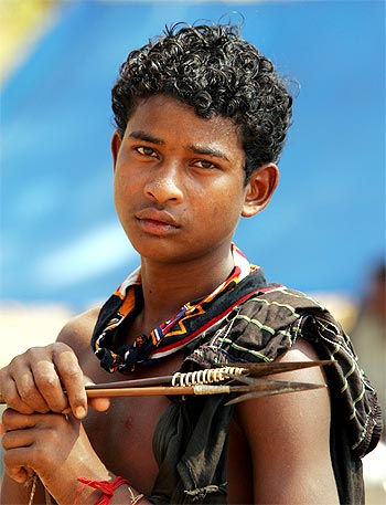 A boy holds a bow and arrow at a relief camp in Dharbaguda, in Chhattisgarh, where violence has mounted since the state government started funding an anti-Maoist movement