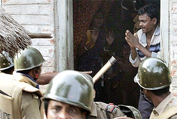 A villager begs a policeman to spare him from being arrested at Pirakata near Lalgarh, West Bengal, June 18, 2009