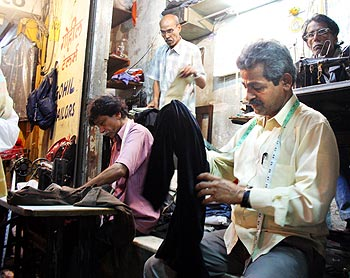 Vasant Gohil in his open air tailoring stall next to Leopold Cafe.