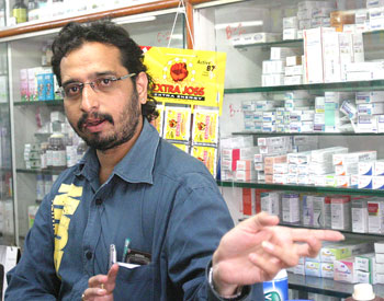 Bharat Waghela at his medicine store. He lost his brother in the shootout.