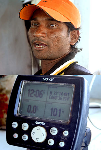 Narsi Thakker and the GPS installed on his boat Tej Vishwa at Jakhau.