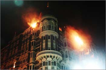 A portion of the Taj Mahal hotel on fire during the 26/11 attack
