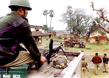Security personnel keep a watch in a Naxal-infested village in Bihar.