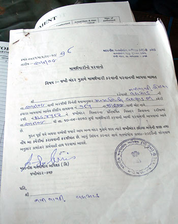 A copy of the fishing permit issued to a tandel, whose boat is registered in Valsad, by Fisheries, Jakhau; some details deleted on request