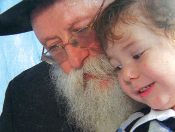 Little Moshe Holtzberg with his maternal grandfather Shimon Rosenberg in a recent picture.