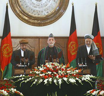 Afghan President Hamid Karzai flanked by Vice-Presidents Mohammad Qasim Fahim, left, Karim Khalili