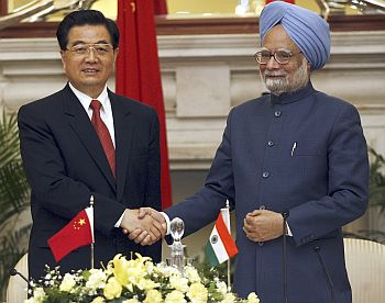 Prime Minister Manmohan Singh greets China's President Hu Jintao.