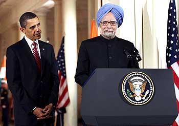 Prime Minister Dr Singh speaks as Obama listens in rapt attention