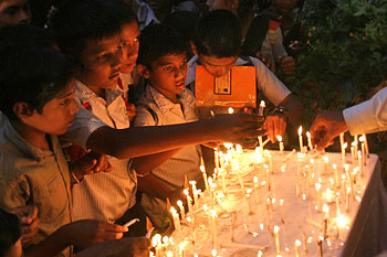 Children lighting candles at the venue