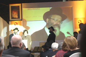 Nachman Holtzberg, Gavriel's father speaks. At his side is Gavriel's mother, Freida