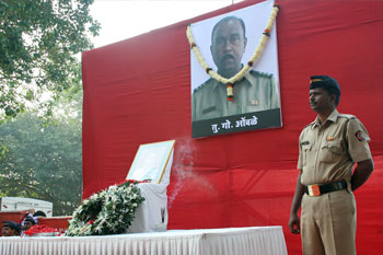 Assistant Sub-Inspector Tukaram Omble's portrait was garlanded at Chowpatty by Mumbai's top cops.