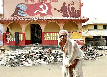 A woman outside a CPI-M office, wrecked by the Maoists in Lalgarh, Bengal