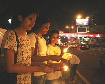 Children light up candles in memory