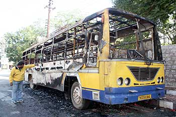 Charred remains of a bus set ablaze by an unruly mob