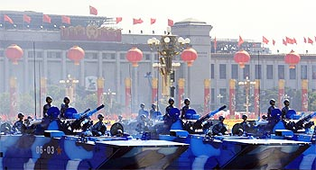 Marine corps vehicles rumble pass Tiananmen Square