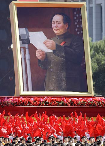 Participants hold a portrait of China's late Chairman Mao Zedong during the parade