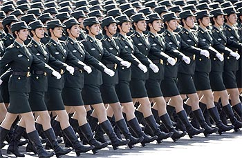 Female soldiers from the Chinese People's Liberation Army march in formation past Tiananmen Square