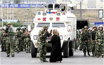 A woman argues with a soldier in Urumqi, China's troubled Xinjiang province