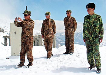 A Chinese soldier takes photographs at Nathu La in Sikkim in 2005.