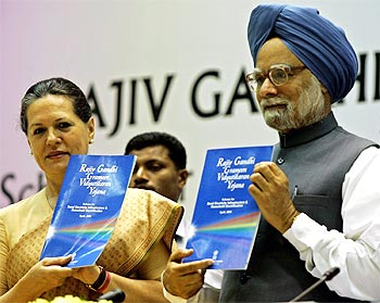 Prime Minister Manmohan Singh and Congress President Sonia Gandhi launch an electricity scheme.