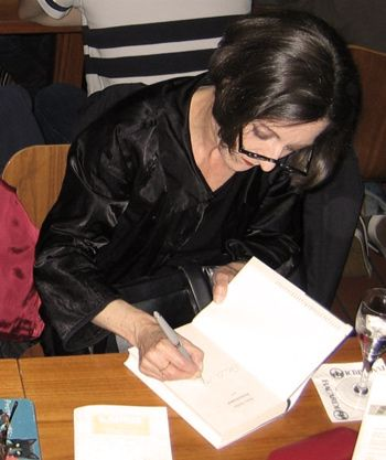 Herta Muller signing her new book Atemschaukel in a German book store