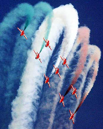Suryakiran jet trainers perform during the Indian Air Force Day celebrations